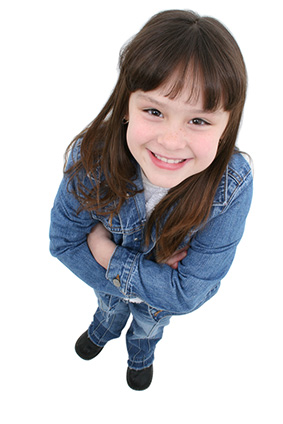 Girl with arms crossed smiling - Pediatric Dentist and Orthodontics in Newark, NJ
